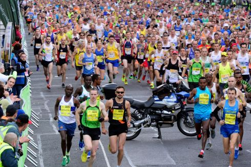 The start of the Dublin Marathon as the elite riunners  runners  met a motor bike on the course. Photograph: Cyril Byrne