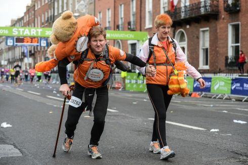 Eddie Hughes and Suzanne Redmond from Firhouse, Dublin who cycled to the start line from Galway and walked the marathon in aid of Cycle against Suicide. Photograph: Cody Glenn/Sportsfile