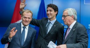 At a press conference at the end of an EU-Canada summit where they signed the agreement on the Comprehensive Economic and Trade Agreement (CETA), a planned EU-Canada free trade agreement, in Brussels, were (from left) EU Council president Donald Tusk, Canadian prime minister Justin Trudeau  and president of the European Commission, Jean-Claude Juncker. Photograph:  EPA/Stephanie Lecocq