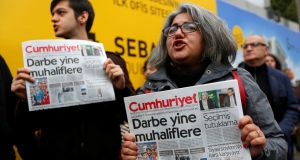 Supporters of the  Cumhuriyet newspaper, an opposition secularist daily, whose editor and 12 senior staff have been detained, protest in front of its headquarters in Istanbul at the weekend. Photograph: Murad Sezer/Reuters