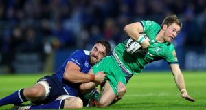 Leinster's Jack Conan tackles Connacht's Kieran Marmion during the PRO12 clash at the RDS. Photograph: James Crombie/Inpho