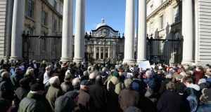Pensioners protest outside Government Buildings last year. By 2055,  just two people are estimated will be working for every person in retirement, compared to about five today. Photograph: Dara Mac Dónaill/The Irish Times