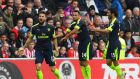 Arsenal substitute Olivier Giroud  celebrates with Mohamed Elneny and Francis Coquelin after scoring the first of his two goals  against  Sunderland at the Stadium of Light.  Photo:  Stu Forster/Getty Images