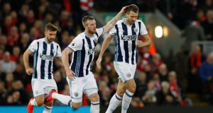 Chris Brunt (L) has returned to the Northern Ireland squad with Gareth McAuley also selected. Photograph: Reuters