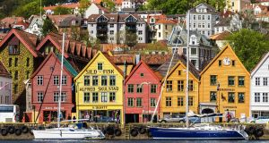 Bryggen, the oldest part of Bergen, is full of colourful, reconstructed Hanseatic buildings. Photograph: Marco Wong/Getty Images