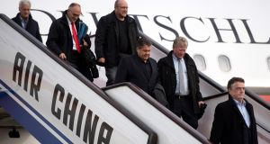 Germany's minister for economic affairs Sigmar Gabriel, centre,  and his delegation arrive  at the airport in Beijing, China, on Tuesday. Photograph: EPA/Bernd Von Jutrczenka