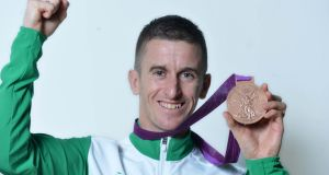 Olympian Rob Heffernan with his bronze medal: he received the medal at a ceremony in Cork City Hall. Photograph: Michael Mac Sweeney/Provision