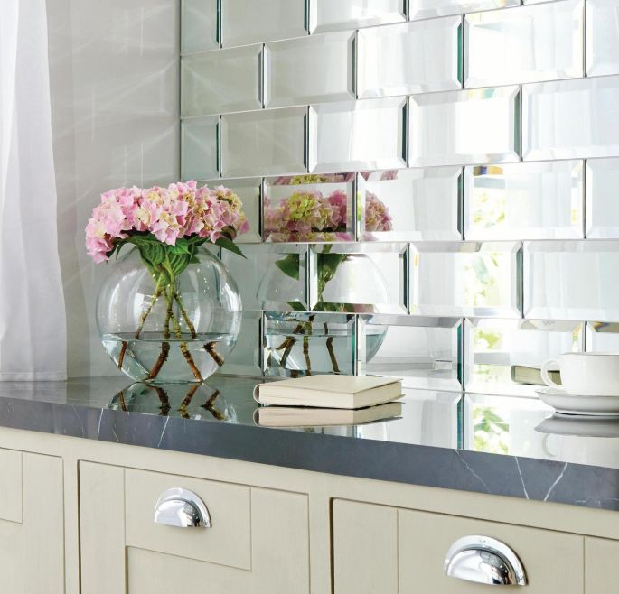 Best in class mirror images panelling a whole wall in antique mirror tiles adds instant glamour to a bathroom to freerunsca Image collections