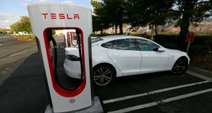 A Tesla Model S charges at a Supercharger station. The tech car firm has announced Irish prices for the Model S saloon and Model X SUV. It will open a store in Ireland in 2017 and install Superchargers in four sites. Photograph: Sam Mircovich/Reuters