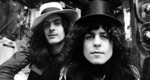 Seminal glam figure Marc Bolan, right, seen here with T Rex percussionist Mickey Finn. Photograph: Hulton Archive