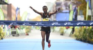Dereje Debele Tulu from Ethiopia crosses the line to win the SSE Airtricity Dublin Marathon 2016. Photograph: Stephen McCarthy/Sportsfile