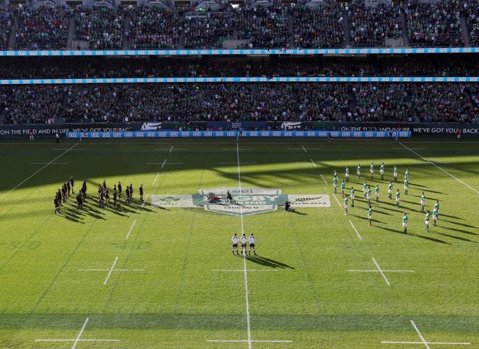 Ireland face the Haka in a shape of eight in memory of Anthony Foley of Munster. Photo: Billy Stickland/Inpho