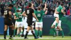 Ireland players celebrate their first  victory over New Zealand. Photograph: Getty