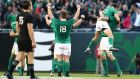 Ireland players celebrate their 40-29 victory as the final whistle blows during the international match between Ireland and New Zealand at Soldier Field  in Chicago. Photograph: Getty