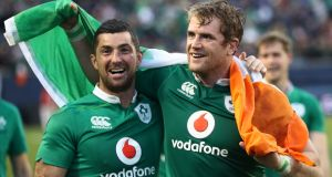 Ireland players Rob Kearney (left) and Jamie Heaslip celebrate following their 40-29 victory over New Zealand. Photograph: Getty