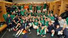 The Ireland team and management celebrate in the dressing-room of Soldier Field. Photograph: Dan Sheridan/Inpho