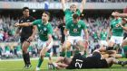 Conor Murray, Jared Payne and Jamie Heaslip celebrate Robbie Henshaw's try, which sealed Ireland's victory over New Zealand at Soldier Field – their first over the All Blacks in 111 years. Photograph: Billy Stickland/Inpho