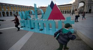 A sign for Europe's biggest tech conference, the Web Summit, at Comercio Square in Lisbon, Portugal. Will the chosen location prove better than Dublin? Photograph: Rafael Marchante