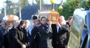 Kitty Fitzgerald's coffin is carried  followed by her husband Tom's coffin. Photograph: Paul Mealey