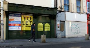 Closed-up shopfronts on  George's Street. A recent survey  reported that 112 shops out of 400 in Dún Laoghaire are vacant. Photograph: Eric Luke