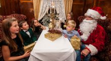 Some children meet Santa at the Pullman Restaurant, two former carriages of the Orient Express, at Glenlo Abbey Hotel in Galway.
