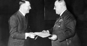 Adolf Hitler awarding his personal physician, Dr Theodor Morell, the Knight's Cross of the War Merit Cross in Berlin, 1944