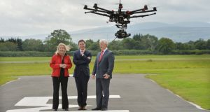 Capt. Julie Garland, chairperson, Unmanned Aircraft Association of Ireland, Paschal O'Donohoe, Minister for Transport, Tourism and Sport and Ralph James, Director of Safety Regulation, Irish Aviation Authority at the inaugural UAAI Open Day 'Meet the Drones'at Weston Airport, Lucan. Photograph: Alan Betson / The Irish Times