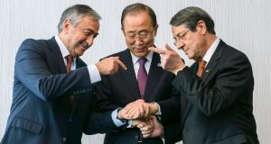 Turkish Cypriot leader Mustafa Akinci, United Nations secretary general Ban Ki-Moon   and Greek Cypriot president Nicos Anastasiades at the    Cyprus peace talks in  Switzerland. Photograph: Fabrice Coffrini/AFP/Getty