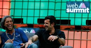Dream Football founder and former soccer player Luis Figo (right) together with his Brazilian team colleague Ronaldinho at the Web Summit in Lisbon. Photograph: EPA