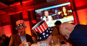Guests attending the viewing party for Election Night 2016 hosted by the US embassy at the Guinness Storehouse, St James Gate, Dublin. Photograph: Dara Mac Dónaill/The Irish Times