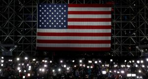 The media gathered beneath the US flag at a Hillary Clinton event in New York on election night. Photograph: Elsa/Getty Images