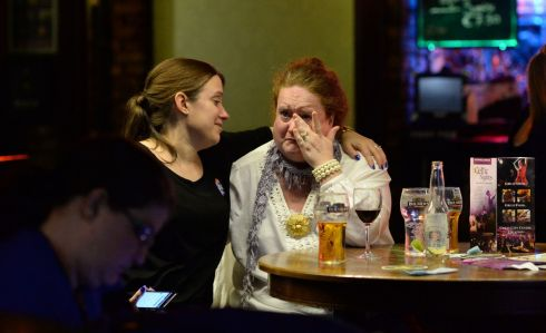 Christina Edwards and Daria Walsh console each other as the Democrats Abroad group watch the closing stages of the US Presidential Election results coming in at the Arlington Hotel, in Dublin. Photograph: Dara Mac Donaill / The Irish Times