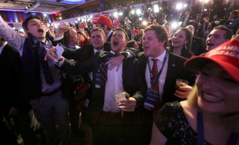 Supporters of U.S. Republican presidential nominee Donald Trump react at his election night rally in Manhattan, New York.  Photograph: Carlo Allegri / Reuters