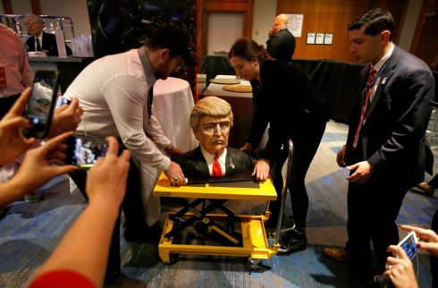 A cake in the form of Republican U.S. presidential nominee Donald Trump is brought into the hotel where his election night rally will be held in Manhattan, New York.  Photograph: Carlo Allegri / Reuters