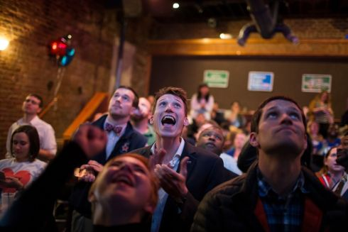 Tim Cwysinski, center, cheers when Hillary Clinton is called in the lead in Virginia during a watch party at On The Rox on Election Day in Richmond, Virginia.   Photograph: Chet Strange/The New York Times