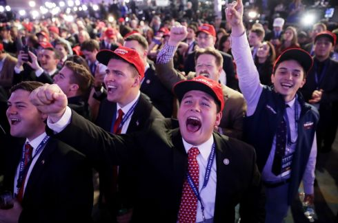 Supporters of Republican presidential nominee Donald Trump cheer during the election night event at the New York Hilton Midtown.  Photograph: Chip Somodevilla/Getty Images