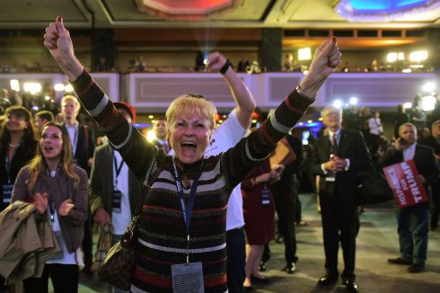 Supporters of Republican presidential nominee Donald Trump react as they watch sate by state results unfold on a TV screen during election night at the New York Hilton Midtown in New York.  Photograph: Mandel Ngan  / AFP