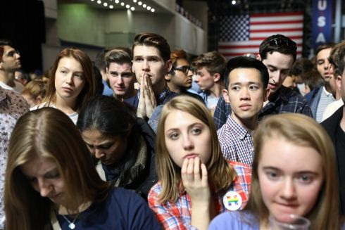 People watch as results come in at Hillary Clinton's election night event at the Javits Center in New York.  Photograph: Todd Heisler/The New York Times
