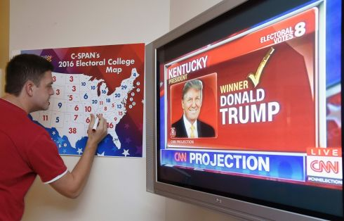 Jake Krupa colors in an electoral map as states projected for Republican presidential nominee Donald Trump or Democratic Presidential nominee Hillary Clinton at an election watching party in Coconut Grove, Florida.  Photograph: Rhona Wise  / AFP