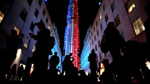 People stop for photographs in front of an Rockefeller Center illuminated in patriotic lights during an Election Day gathering, Tuesday, Nov. 8, 2016, in New York.  Photograph: Julio Cortez  /AP