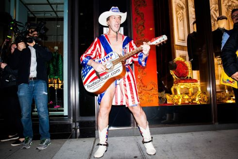 A man plays guitar outside of Trump Tower before the results of the 2016 U.S. Presidential Election in New York.  Photograph: David Williams / Bloomberg