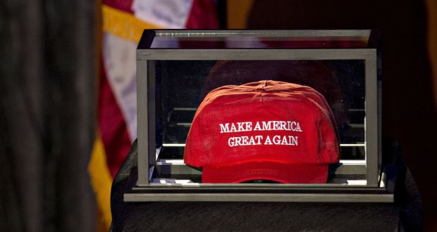 fc9cddea19b A  Make America Great Again  hat sits in a case on the stage in