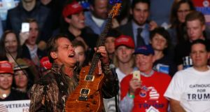 Ted Nugent performs  prior to the arrival of  Donald Trump and Mike Pence for their final campaign event of the 2016 presidential election. Photograph: Jeff Kowalsky/AFP/Getty