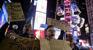 Celebrations in Times Square, Manhattan,  early on Wednesday. Photograph: Reuters/Bria Webb