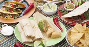 Tacos and tamales. Photograph: iStock