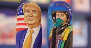 Matryoshka dolls emblazoned with images of US president-elect  Donald Trump and Russian president   Vladimir Putin,  dressed as a military pilot, in a Moscow souvenir shop. Photograph: Andrey Rudakov/Bloomberg