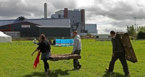Activists protest  near the   ESB peat burning power station   in Shannonbridge, Co Offaly.  Photograph: Julien Behal/PA Wire