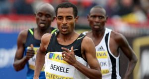 Ethiopian distance runner Kenenisa Bekele, centre,  always stands in good balance and alignment. Photograph: AP Photo/Scott Heppell