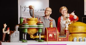 Christine and Phil Jenson of Peboryon with their Wallace and Gromit inspired cake that bakes a cake exhibit at Cake International