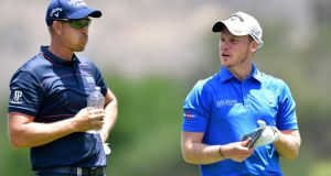 Henrik Stenson   chats to Danny Willett  during the first round of  the Nedbank Golf Challenge at Gary Player CC in Sun City, South Africa. Photograph: Stuart Franklin/Getty Images